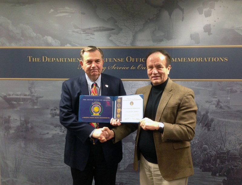 Lt. Gen. Claude M. Kicklighter of the Department of Defense Office of Commemorations presenting John Wiscombe a certificate of partnership with Music Celebrations International - February 2013